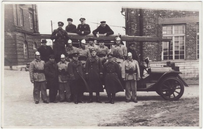 Members of the Tallinn Arsenal Voluntary Fire Defense Team at the fire extinguishing car.  duplicate photo