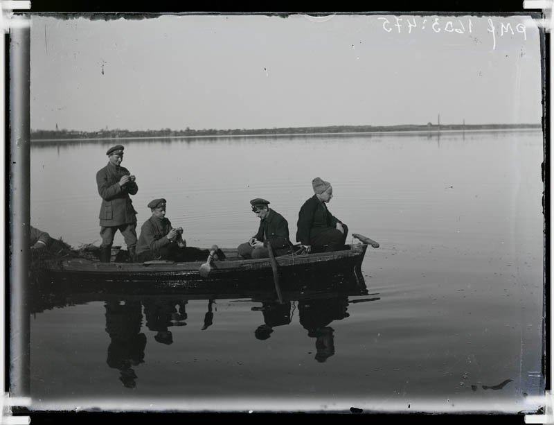 Glass negative, military-formed men on a boat on lake 1918-20. Rose
