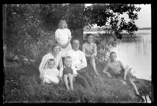 Clothing for men, women and children - family in the summer of the lake