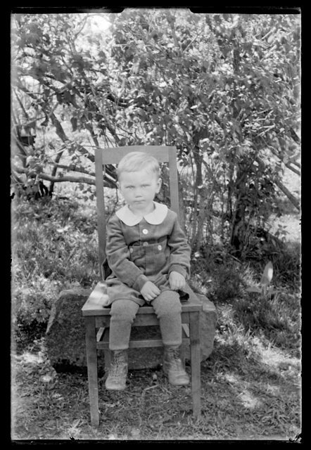 Children's clothing - a small boy on the chair