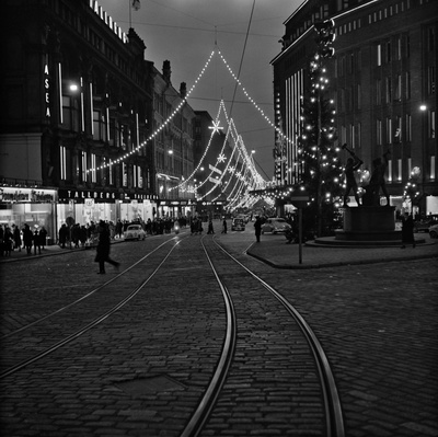 Aleksanterkatu on Christmas, described at the three-sea square on the Day of Independence. Stockmann's store on the right.  similar photo