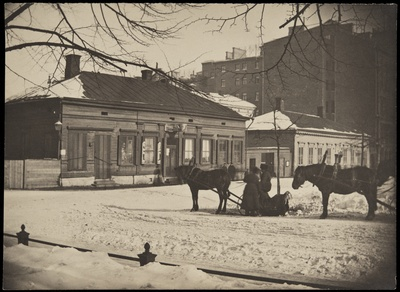 Northern Esplanaadikatu (=Pohjoisesplanadi) 33 (Mikonkatu 1) and 31 (Architect Theodor Höijer, coach. 1889) in winter. In front of the horse racing, in the wooden house on the left of the mouth f. a. Loström movement. The wooden building was completed in 1892 by Selim a. Lindqvist.  similar photo