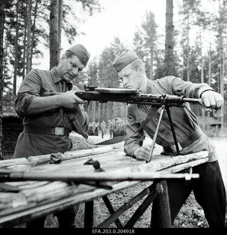 "A scene from the Tallinn Film game film ""People in Soldiers"". The guns are handled by Tääger (Heino Raudsik) and Five (Kenno Oja)."