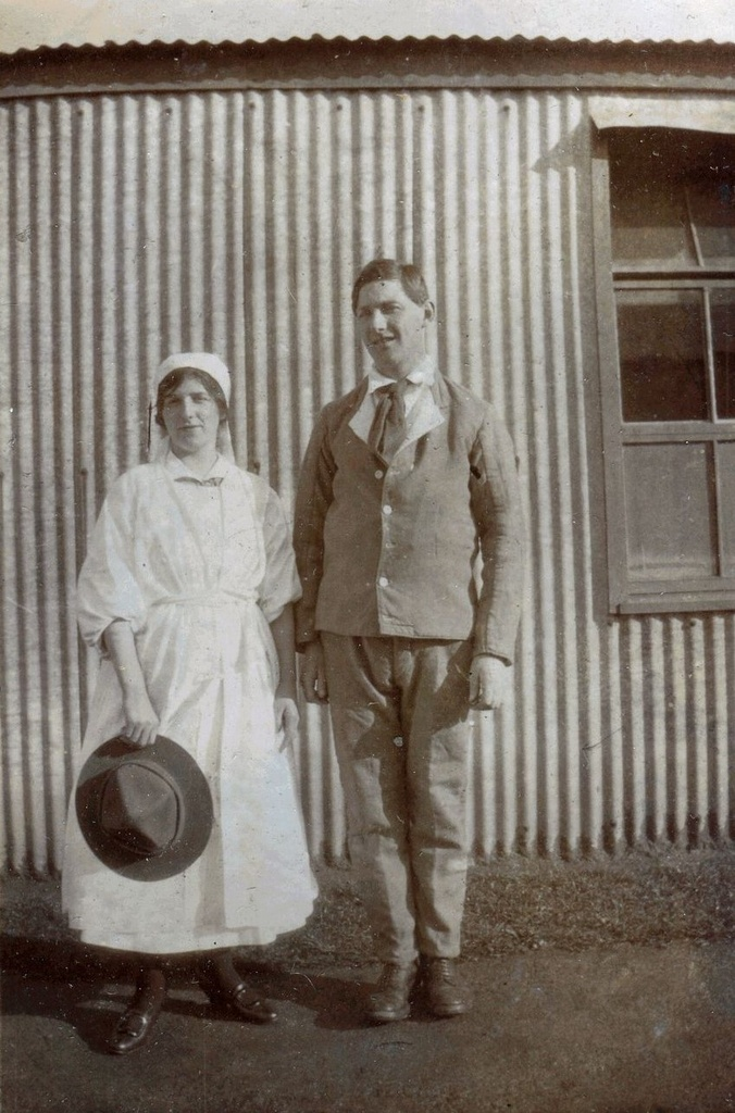 Nurse standing with man, Tin Town, Brockenhurst, 1918