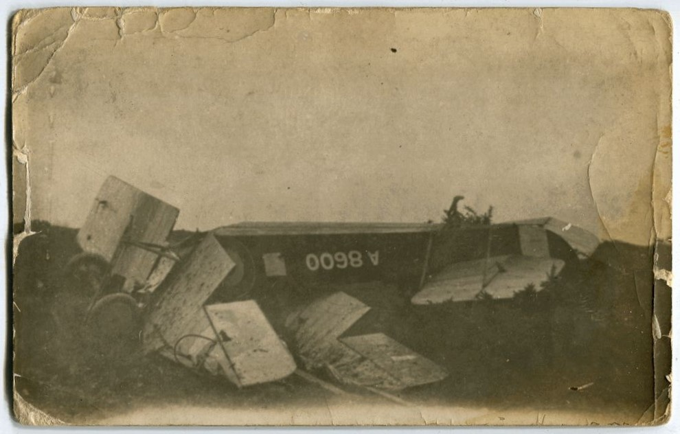 Avro 504 (A8600) bi-plane crash, upside down fuselage