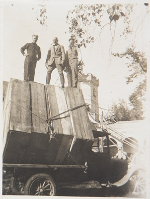 Studies for the Kalevala frescoes ready to be transported from Tarvaspää to the National Museum of Finland; Akseli and Jorma Gallen-Kallela and Yrjö Lampila staying on the load, 1928; print 2 of the photograph.  duplicate photo